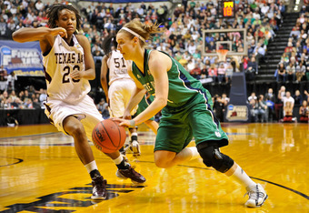 INDIANAPOLIS, IN - APRIL 5:  Natalie Novosel #21 of the Notre Dame Fighting Irish controls the ball as Tyra White #20 of the Texas A&M Aggies defends during the 2011 NCAA Women's Final Four championship game at Conseco Fieldhouse on April 5, 2011 in India