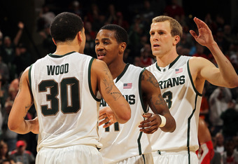 INDIANAPOLIS, IN - MARCH 11:  (L-R) Brandon Wood #30, Keith Appling #11 and Austin Thornton #13 of the Michigan State Spartans celebrate against the Ohio State Buckeyes during the Final Game of the 2012 Big Ten Men's Conference Basketball Tournament at Ba