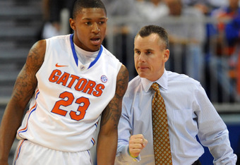 GAINESVILLE, FL -  NOVEMBER 11:  Guard Bradley Beal #23 of the Florida Gators listens to coach Billy Donovan during play against the Jackson State Tigers November 11, 2011 at the Stephen C. O'Connell Center in Gainesville, Florida.  (Photo by Al Messersch