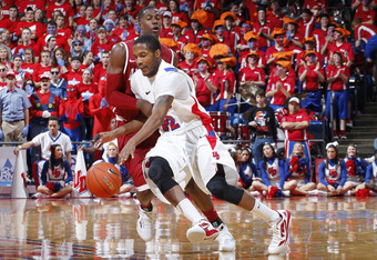 DAYTON, OH - DECEMBER 7: Paul Williams #22 of the Dayton Flyers brings the ball up court against the Alabama Crimson Tide at University of Dayton Arena on December 7, 2011 in Dayton, Ohio. Dayton defeated Alabama 74-62. (Photo by Joe Robbins/Getty Images)