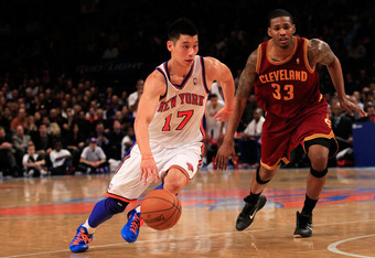 NEW YORK, NY - FEBRUARY 29:  Jeremy Lin #17 of the New York Knicks drives against Alonzo Gee #33 of the Cleveland Cavaliers at Madison Square Garden on February 29, 2012 in New York City. NOTE TO USER: User expressly acknowledges and agrees that, by downl