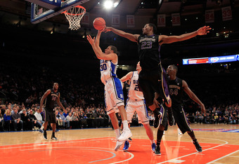 NEW YORK, NY - DECEMBER 10: Seth Curry #30 of the Duke Blue Devils shoots past C.J. Wilcox #23 of the Washington Huskies at Madison Square Garden on December 10, 2011 in New York City.  (Photo by Chris Trotman/Getty Images)