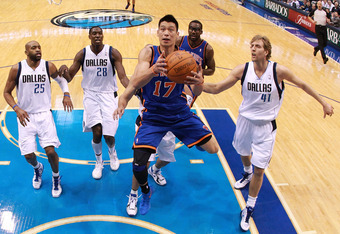 DALLAS, TX - MARCH 06:  Jeremy Lin #17 of the New York Knicks takes a shot against Dirk Nowitzki #41 of the Dallas Mavericks at American Airlines Center on March 6, 2012 in Dallas, Texas.  NOTE TO USER: User expressly acknowledges and agrees that, by down