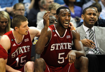 ATLANTA, GA - MARCH 10:   C.J. Leslie #5 of the North Carolina State Wolfpack reacts on the bench after fouling out against the North Carolina Tar Heels with his teammate Scott Wood #15 during the semifinals of the 2012 ACC Men's Basketball Conference Tou
