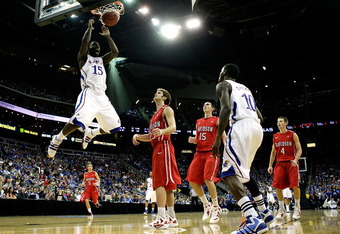 KANSAS CITY, MO - DECEMBER 19:  Elijah Johnson #15 of the Kansas Jayhawks dunks during the game against the Davidson Wildcats on December 19, 2011 at the Sprint Center in Kansas City, Missouri.  (Photo by Jamie Squire/Getty Images)