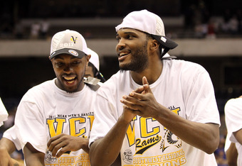 SAN ANTONIO, TX - MARCH 27:  (L-R) Ed Nixon #50 and Jamie Skeen #21 of the Virginia Commonwealth Rams celebrate after defeating the Kansas Jayhawks during the southwest regional final of the 2011 NCAA men's basketball tournament at the Alamodome on March