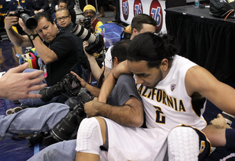 LOS ANGELES, CA - MARCH 09:  Jorge Gutierrez #2 of the California Golden Bears falls into a row of photographers as he attempts to save the ball in the second half against the Colorado Buffaloes in the semifinals of the 2012 Pacific Life Pac-12 men's bask