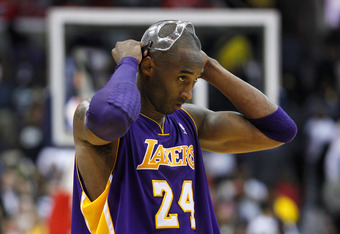 WASHINGTON, DC - MARCH 07: Kobe Bryant #24 of the Los Angeles Lakers adjusts his mask during the closing moments of the Lakers 106-101 loss to the Washington Wizards at the Verizon Center on March 7, 2012 in Washington, DC. NOTE TO USER: User expressly ac