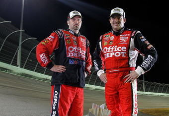 HOMESTEAD, FL - NOVEMBER 21:  Tony Stewart (R), driver of the #14 Office Depot/Mobil 1 Chevrolet, and crew chief Darian Grubb (L) pose with the championship trophy after winning the NASCAR Sprint Cup Series Ford 400 and the 2011 Series Championship at Hom