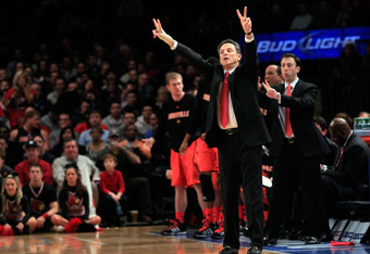 NEW YORK, NY - MARCH 10:  Head coach Rick Pitino of the Louisville Cardinals gestures from the sidelines against the Cincinnati Bearcats during the finals of the Big East Men's Basketball Tournament at Madison Square Garden at Madison Square Garden on Mar