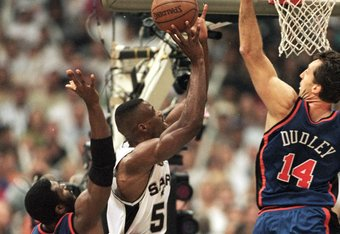 16 Jun 1999: David Robinson #50 of the San Antonio Spurs takes the shot as he is blocked by Chris Dudley #14 of the New York Knicks during the NBA Finals game at the Alamodome in San Antonio, Texas. The Spurs defeated the Knicks 89-77.  Mandatory Credit: