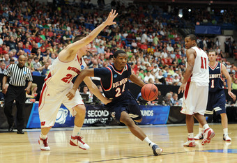 TUCSON, AZ - MARCH 17:  Adam Barnes #24 of the Belmont Bruins drives against Josh Gasser #21 of the Wisconsin Badgers during the second round of the 2011 NCAA men's basketball tournament at McKale Center on March 17, 2011 in Tucson, Arizona.  (Photo by Ha