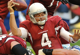 GLENDALE, AZ - DECEMBER 04:  Kevin Kolb #4 of the Arizona Cardinals holds onto the ball as he gets sacked against the Dallas Cowboys at University of Phoenix Stadium on December 4, 2011 in Glendale, Arizona.  (Photo by Norm Hall/Getty Images)
