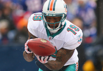 ORCHARD PARK, NY - DECEMBER 18:  Brandon Marshall #19 of the Miami Dolphins drops a touchdown pass against the Buffalo Bills at Ralph Wilson Stadium  on December 18, 2011 in Orchard Park, New York.  (Photo by Rick Stewart/Getty Images)