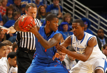 NEW ORLEANS, LA - MARCH 10:  Kenny Boynton #1 of the Florida Gators controls the ball as Doron Lamb #20 of the Kentucky Wildcats defends in the first half during the semifinals of the SEC Men's Basketball Tournament at New Orleans Arena on March 10, 2012