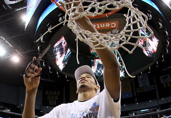 LOS ANGELES, CA - MARCH 10:  Andre Roberson #21 of the Colorado Buffaloes cuts down the net after the Buffaloes 53-51 victory against the Arizona Wildcats in the championship game of the Pacific Life Pac-12 basketball tournament at Staples Center on March