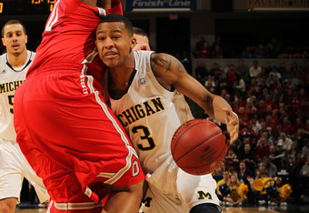 INDIANAPOLIS, IN - MARCH 10:  Trey Burke #3 of the Michigan Wolverines drives against the Ohio State Buckeyes during their Semifinal game of the 2012 Big Ten Men's Basketball Conference Tournament at Bankers Life Fieldhouse on March 10, 2012 in Indianapol