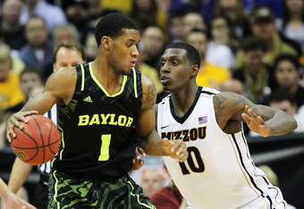 KANSAS CITY, MO - MARCH 10:  Perry Jones III #1 of the Baylor Bears drives against Ricardo Ratliffe #10 of the Missouri Tigers in the first half during the championship game of the 2012 Big 12 Men's Basketball Tournament at Sprint Center on March 10, 2012