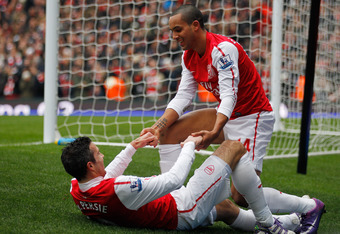 LONDON, ENGLAND - FEBRUARY 04:  Theo Walcott and Robin van Persie of Arsenal celebrate after scoring their second goal of the match during the Barclays Premier League match between Arsenal and Blackburn Rovers at Emirates Stadium on February 4, 2012 in Lo