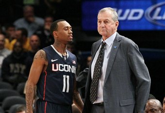 NEW YORK, NY - MARCH 07:  Head coach Jim Calhoun and Ryan Boatright #11 of the Connecticut Huskies of the Connecticut Huskies against the West Virginia Mountaineers during their second round game of the 2012 Big East Men's Basketball Tournament at Madison