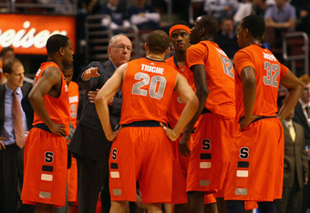 PHILADELPHIA, PA - JANUARY 11:  Head coach Jim Boeheim of the Syracuse Orange talks with (in uniform L-R) Scoop Jardine #11, Brandon Triche #20, C.J. Fair #5, Baye Moussa Keita #12 and Kris Joseph #32 during a timeout against the Villanova Wildcats at the