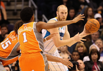 PHOENIX, AZ - DECEMBER 26:  Chris Kaman #35 of the New Orleans Hornets handles the ball during the season openning NBA game against the Phoenix Suns at US Airways Center on December 26, 2011 in Phoenix, Arizona.  The Hornets defeated the Suns 85-84. NOTE