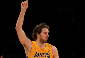 LOS ANGELES, CA - FEBRUARY 14:  Pau Gasol #16 of the Los Angeles Lakers celebrates after making a three point basket against the Atlanta Hawks at Staples Center on February 14, 2012 in Los Angeles, California.  The Lakers won 86-78.  NOTE TO USER: User ex