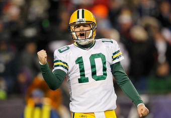 FOXBORO, MA - DECEMBER 19:  Quarterback Matt Flynn #10 of the Green Bay Packers celebrates a touchdown during the second quarter of the game against the New England Patriots at Gillette Stadium on December 19, 2010 in Foxboro, Massachusetts.  (Photo by Ji