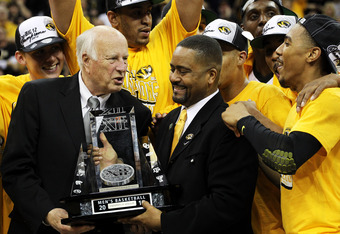KANSAS CITY, MO - MARCH 10:  Big 12 Interim Commissioner Chuck Neinas presents Head coach Frank Haith of the Missouri Tigers with the trophy after they defeated the Baylor Bears 90 to 75 to win the championship game of the 2012 Big 12 Men's Basketball Tou