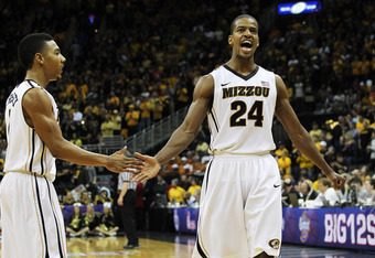 KANSAS CITY, MO - MARCH 10:  Kim English #24 and Phil Pressey #1 of the Missouri Tigers celebrate during their 90 to 75 win over the Baylor Bears the championship game of the 2012 Big 12 Men's Basketball Tournament at Sprint Center on March 10, 2012 in Ka