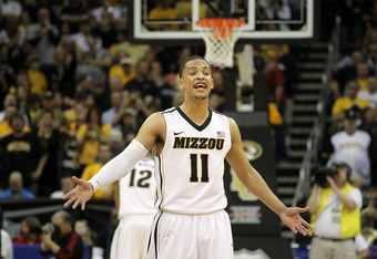 KANSAS CITY, MO - MARCH 10:  Michael Dixon #11 of the Missouri Tigers celebrates after the Tigers defeated the Baylor Bears 90 to 75 to win the championship game of the 2012 Big 12 Men's Basketball Tournament at Sprint Center on March 10, 2012 in Kansas C