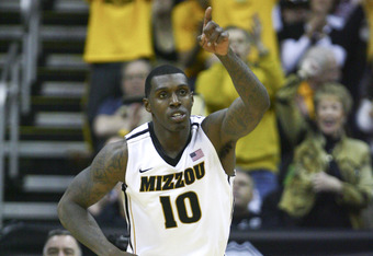KANSAS CITY, MO - MARCH 10:  Ricardo Ratliffe #10 of the Missouri Tigers celebrates a shot against the Baylor Bears during the championship game of the Big 12 Basketball Tournament March 10, 2012 at Sprint Center in Kansas City, Missouri.  (Photo by Ed Zu