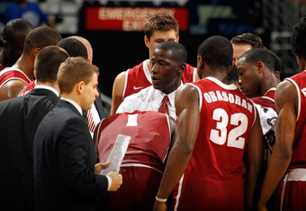 NEW ORLEANS, LA - MARCH 09:  Head coach Anthony Grant of the Alabama Crimson Tide talks with his plaers during a timeout against the Florida Gators during their quarterfinal game in the 2012 SEC Men's Basketball Conference Tournament at New Orleans Arena