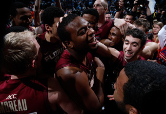ATLANTA, GA - MARCH 11:  Antwan Space #24 and the Florida State Seminoles celebrate after their 85-82 win over the North Carolina Tar Heels in the Final Game of the 2012 ACC Men's Basketball Conference Tournament at Philips Arena on March 11, 2012 in Atla
