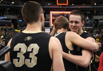 LOS ANGELES, CA - MARCH 10:  Shane Harris-Tunks #15 and Austin Dufault #33 of the Colorado Buffaloes celebrate after the Buffaloes 53-51 victory against the Arizona Wildcats in the championship game of the Pacific Life Pac-12 basketball tournament at Stap