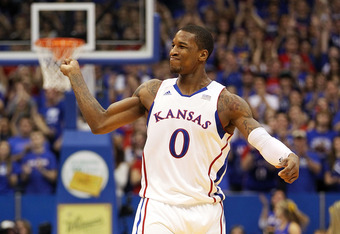 LAWRENCE, KS - JANUARY 04:  Thomas Robinson #0 of the Kansas Jayhawks celebrates after scoring during the game against  the Kansas State Wildcats on January 4, 2012 at Allen Fieldhouse in Lawrence, Kansas.  (Photo by Jamie Squire/Getty Images)
