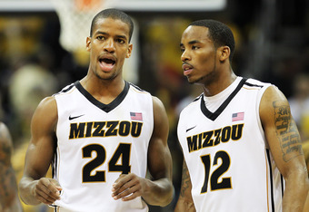 KANSAS CITY, MO - MARCH 10:  Kim English #24 and Marcus Denmon #12 of the Missouri Tigers talk in the second half against the Baylor Bears during the championship game of the 2012 Big 12 Men's Basketball Tournament at Sprint Center on March 10, 2012 in Ka