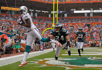 MIAMI GARDENS, FL - DECEMBER 11:  Brandon Marshall #19 of the Miami Dolphins catches a touchdown pass against  Nnamdi Asomugha #24 of the Philadelphia Eagles during a game  at Sun Life Stadium on December 11, 2011 in Miami Gardens, Florida.  (Photo by Mik