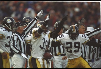 5 Nov 1995:  Free Safety Darren Perry #39 and defensive back Randy Fuller #29 of the Pittsburgh Steelers signals with the officials there is a turnover against the Chicago Bears at Soldier Field in Chicago, Illinois.  The Steelers defeated the Bears 37-34