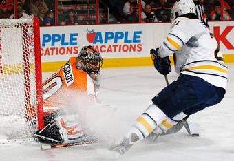 PHILADELPHIA, PA - FEBRUARY 16:  Ilya Bryzgalov #30 of the Philadelphia Flyers makes a save against Drew Stafford #21 of the Buffalo Sabres during their game on February 16, 2012 at The Wells Fargo Center in Philadelphia, Pennsylvania.  (Photo by Al Bello