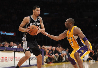 LOS ANGELES, CA - APRIL 12:  Danny Green #4 of the San Antonio Spurs looks to pass in front of Kobe Bryant #23 of the Los Angeles Lakers at Staples Center on April 12, 2011 in Los Angeles, California.  NOTE TO USER: User expressly acknowledges and agrees