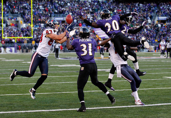 BALTIMORE, MD - JANUARY 15:  Ed Reed #20 of the Baltimore Ravens breaks up a pass intended for  Kevin Walter #83 of the Houston Texans during the fourth quarter of the AFC Divisional playoff game at M&T Bank Stadium on January 15, 2012 in Baltimore, Maryl