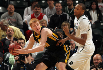 Iowa's Aaron White (left) had a career-high 25 points in the NIT win over Dayton.