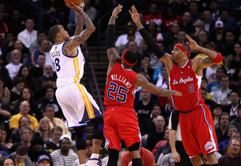 OAKLAND, CA - FEBRUARY 20:  Monta Ellis #8 of the Golden State Warriors shoots over Mo Williams #25 and Kenyon Martin #2 of the Los Angeles Clippers at Oracle Arena on February 20, 2012 in Oakland, California.  NOTE TO USER: User expressly acknowledges an