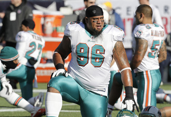 FOXBORO, MA - DECEMBER 24: Paul Soliai #96 of the Miami Dolphins prior to a game between the New England Patriots and the Miami Dolphins at Gillette Stadium on December 24, 2011 in Foxboro, Massachusetts.  (Photo by Winslow Townson/Getty Images)
