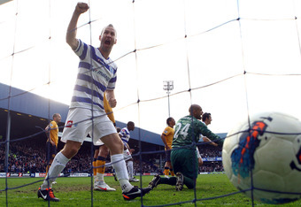 LONDON, ENGLAND - MARCH 03:  Shaun Derry of QPR celebrates Bobby Zamora's headed goal during the Barclays Premier League match between Queens Park Rangers and Everton at Loftus Road on March 3, 2012 in London, England.  (Photo by Julian Finney/Getty Image