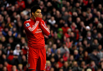 LIVERPOOL, ENGLAND - DECEMBER 10:  Luis Suarez of Liverpool reacts to a missed chance during the Barclays Premier League match between Liverpool and Queens Park Rangers at Anfield on December 10, 2011 in Liverpool, England. (Photo by Clive Brunskill/Getty