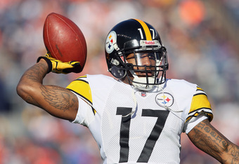 DENVER, CO - JANUARY 08:  Mike Wallace #17 of the Pittsburgh Steelers throws the ball prior to the start of the AFC Wild Card Playoff game against the Denver Broncos at Sports Authority Field at Mile High on January 8, 2012 in Denver, Colorado.  (Photo by