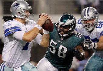 ARLINGTON, TX - DECEMBER 24:  Quarterback Stephen McGee #7 of the Dallas Cowboys is sacked by defensive end Trent Cole #58 of the Philadelphia Eagles at Cowboys Stadium on December 24, 2011 in Arlington, Texas.  (Photo by Tom Pennington/Getty Images)