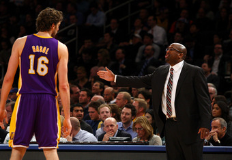 NEW YORK, NY - FEBRUARY 10:  Head coach Mike Brown of the Los Angeles Lakers talks with Pau Gasol #16 against the New York Knicks at Madison Square Garden on February 10, 2012 in New York City.  NOTE TO USER: User expressly acknowledges and agrees that, b